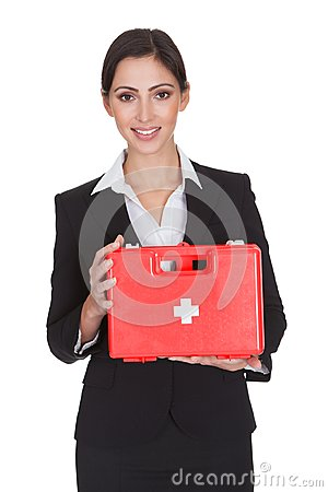 Free Happy Businesswoman Holding First Aid Box Stock Photos - 52428603
