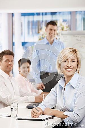 Happy businesswoman on meeting