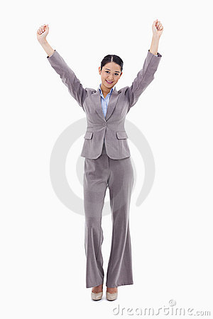 A happy businesswoman posing with the arms up