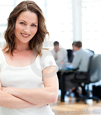 Happy businesswoman posing in front of her team