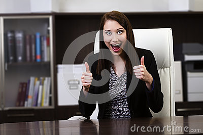 Happy businesswoman showing thumbs up sign
