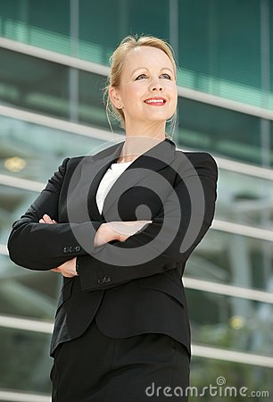 Happy businesswoman smiling outdoors