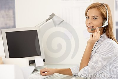 Happy call center worker girl with headset