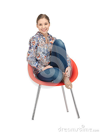 Happy and carefree teenage girl in chair