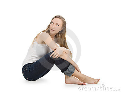 Happy and carefree teenage girl sitting on the