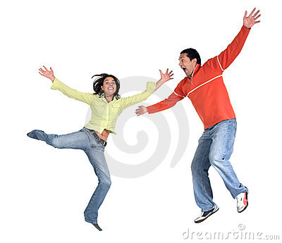 Happy casual couple jumping up