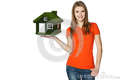 Female holding green eco house