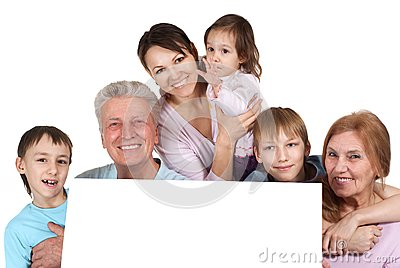 Happy Caucasian family holding the paper