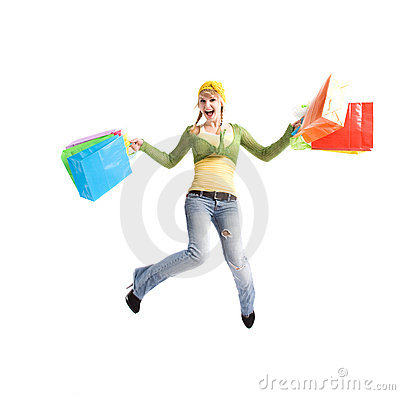 Happy caucasian girl jumping with shopping bags