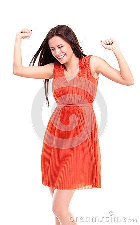 Happy caucasian woman with hands raised celebrating her victory