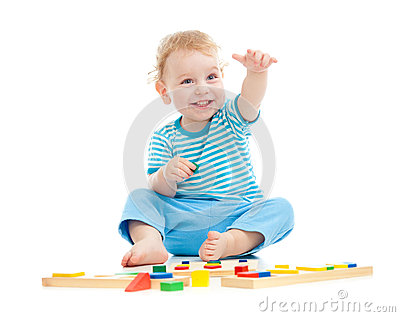 Happy cheerful kid playing educational toys