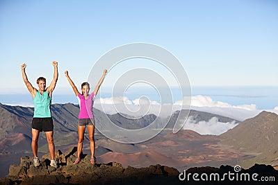 Happy cheering winning success outdoors couple