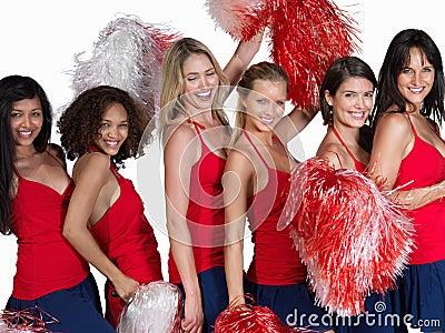 Happy cheerleaders posing