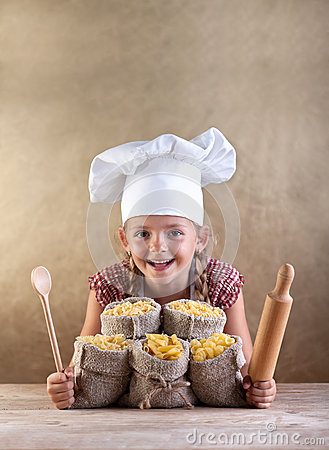 Happy chef child with pasta assortment