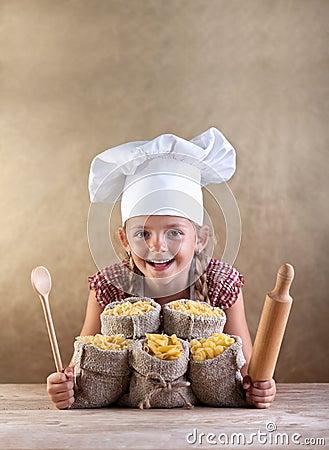 Happy chef child with pasta assortment