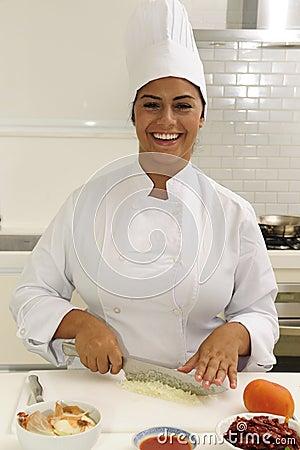 Happy chef cutting onions