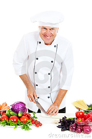 Happy chef preparing salad