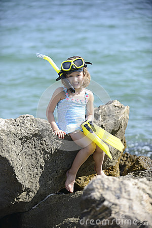 Happy child on the beach with snorkel