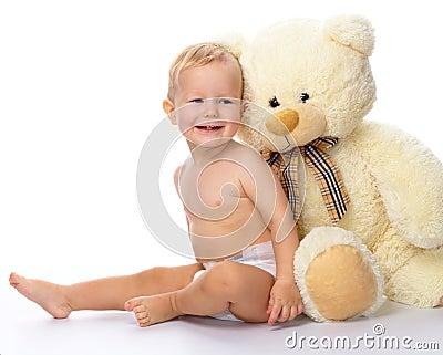 Happy child with big soft bear toy