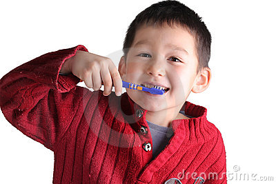A happy child brushing teeth