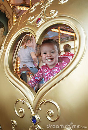 Happy child in carousel