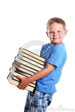 Six years old boy holding a pile of books isolated on white