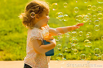 Happy Child Chasing Soap Bubbles Royalty Free Stock ...