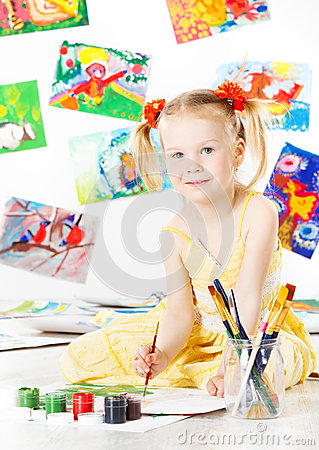 Happy child drawing with gouache color brush