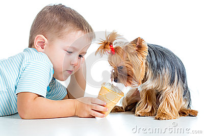Happy child eating ice-cream isolated