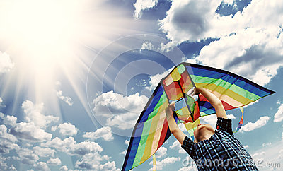Happy child flies a kite in the sky 2