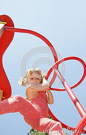 Happy child girl having fun on playground