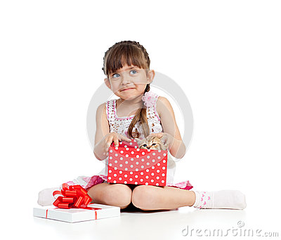 Happy child girl holding gift box with kitten