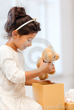 Free Happy Child Girl With Gift Box And Teddy Bear Royalty Free Stock Photography - 35015647