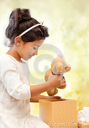 Free Happy Child Girl With Gift Box And Teddy Bear Stock Photos - 37351043