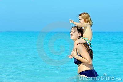 Happy child with her mother on the beach