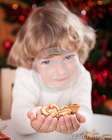 Happy child holding cookies