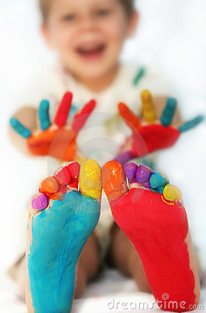 Happy child with painted feet and hands