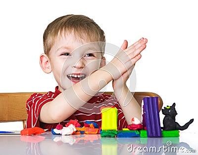 Happy child with plasticine