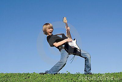 Happy child playing guitar