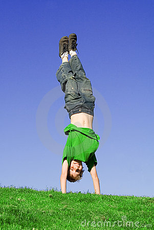 Happy child playing handstand
