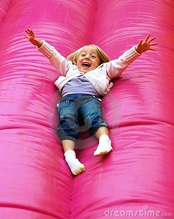 Happy child playing on slide