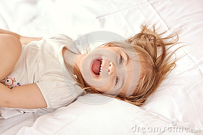 Happy child. Portrait of a beautiful liitle girl Stock Photo