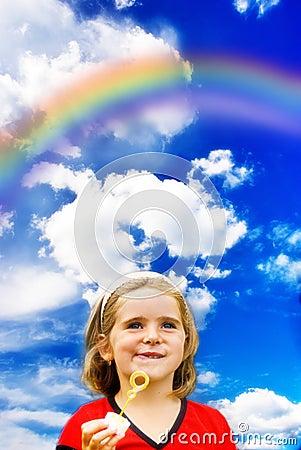 Happy child and rainbow