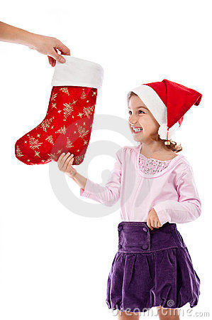 Happy child receiving present at Christmas