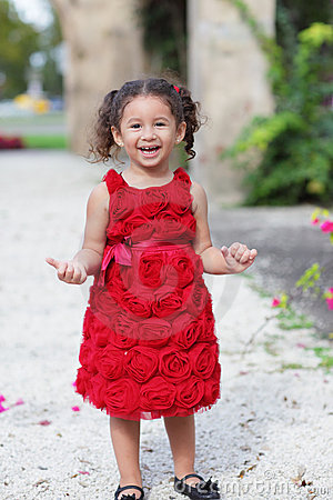 Happy child in a red dress
