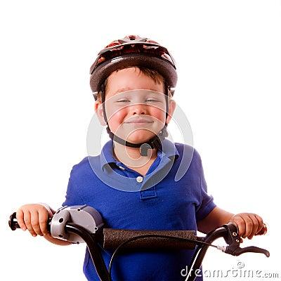 Happy child riding his bike