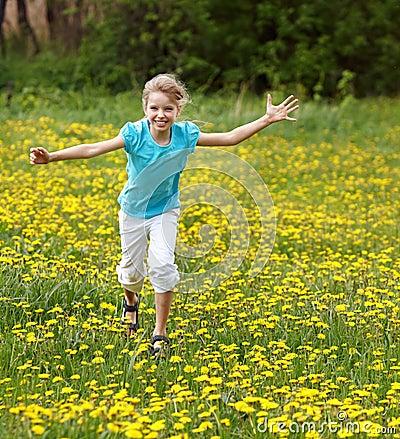 Happy child  running in  field.