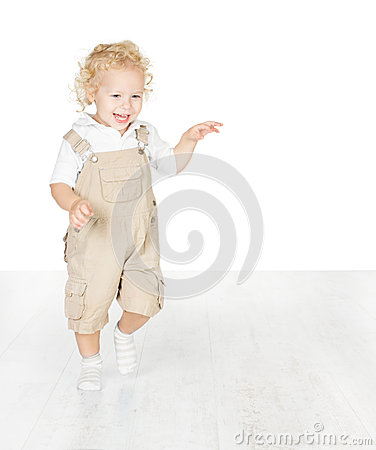 Happy child, running on white floor