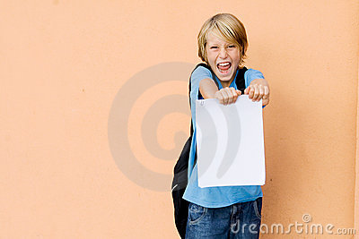 Happy child showing good exam results