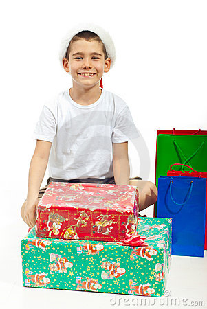 Happy child sitting with Xmas gifts